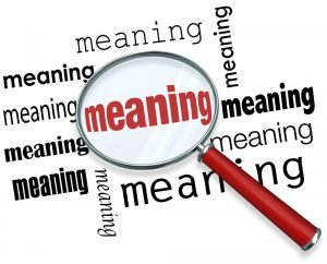 """A magnifying glass is focussed on the word """"meaning"""". And yes, focus on meaning is essential to understand your partner."""