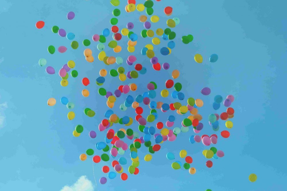 These multi-coloured balloons suggest levity, lightness and happiness. But is happiness aiming too low?